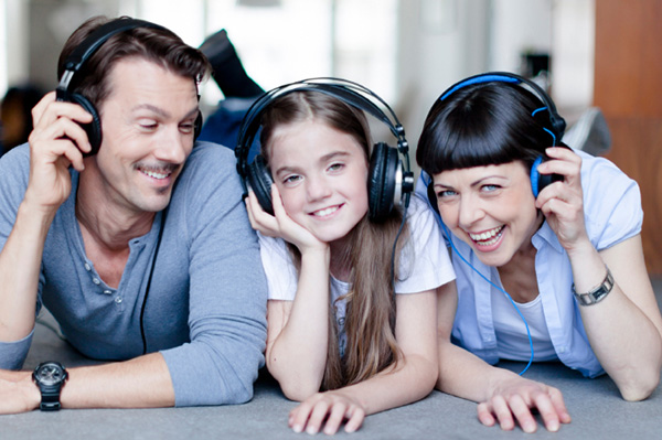 Family-listening-to-music-with-tween-daughter